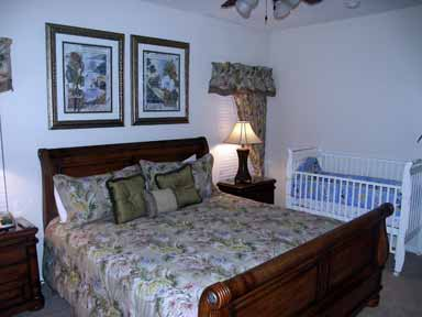 All star vacation homes review Master bedroom with a crib