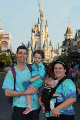Babywearing in front of Cinderella's Castle photo
