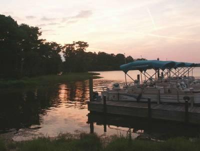 Photo illustrating <font size=1>Fort Wilderness - Boats on Bay Lake
