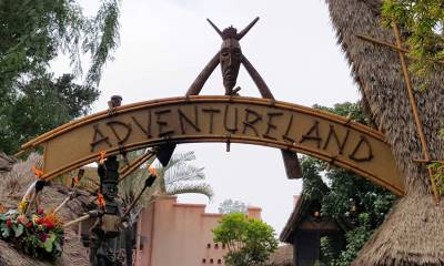 Photo illustrating Disneyland Adventureland sign