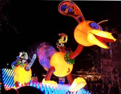 Photo illustrating <font size=1>Disneyland Main Street USA Paint the Night Parade Slink Dog Buzz Woody