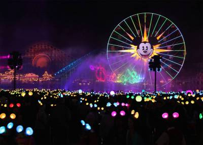 Photo illustrating World of Color and Made with Magic Ears