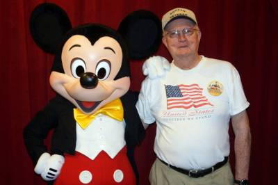 Photo illustrating <font size=1>Dad Poses with Mickey Mouse