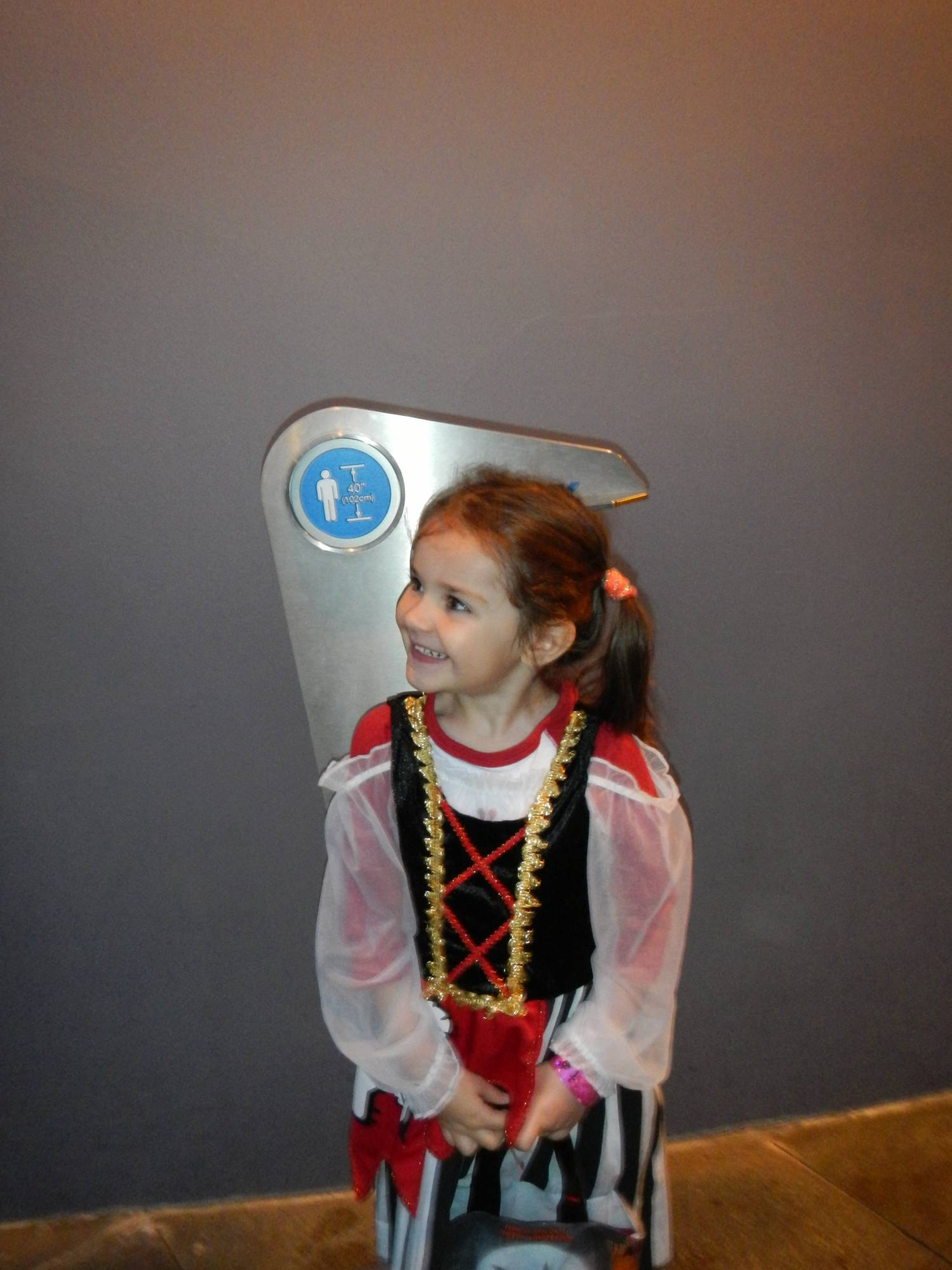 My daughter is excited that she's tall enough to ride Star Tours. photo