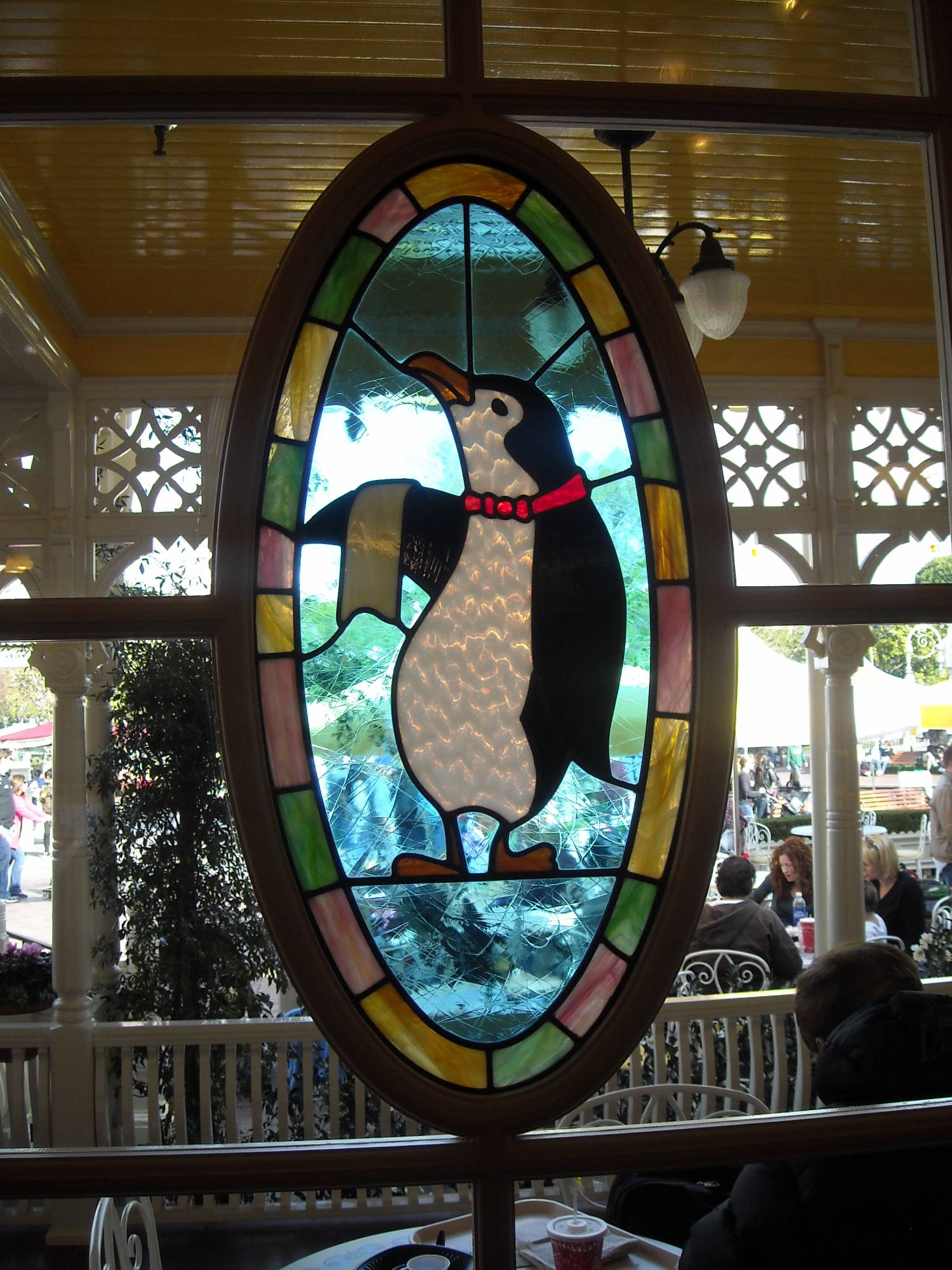Jolly Holiday Bakery Cafe Stained Glass Penguin photo