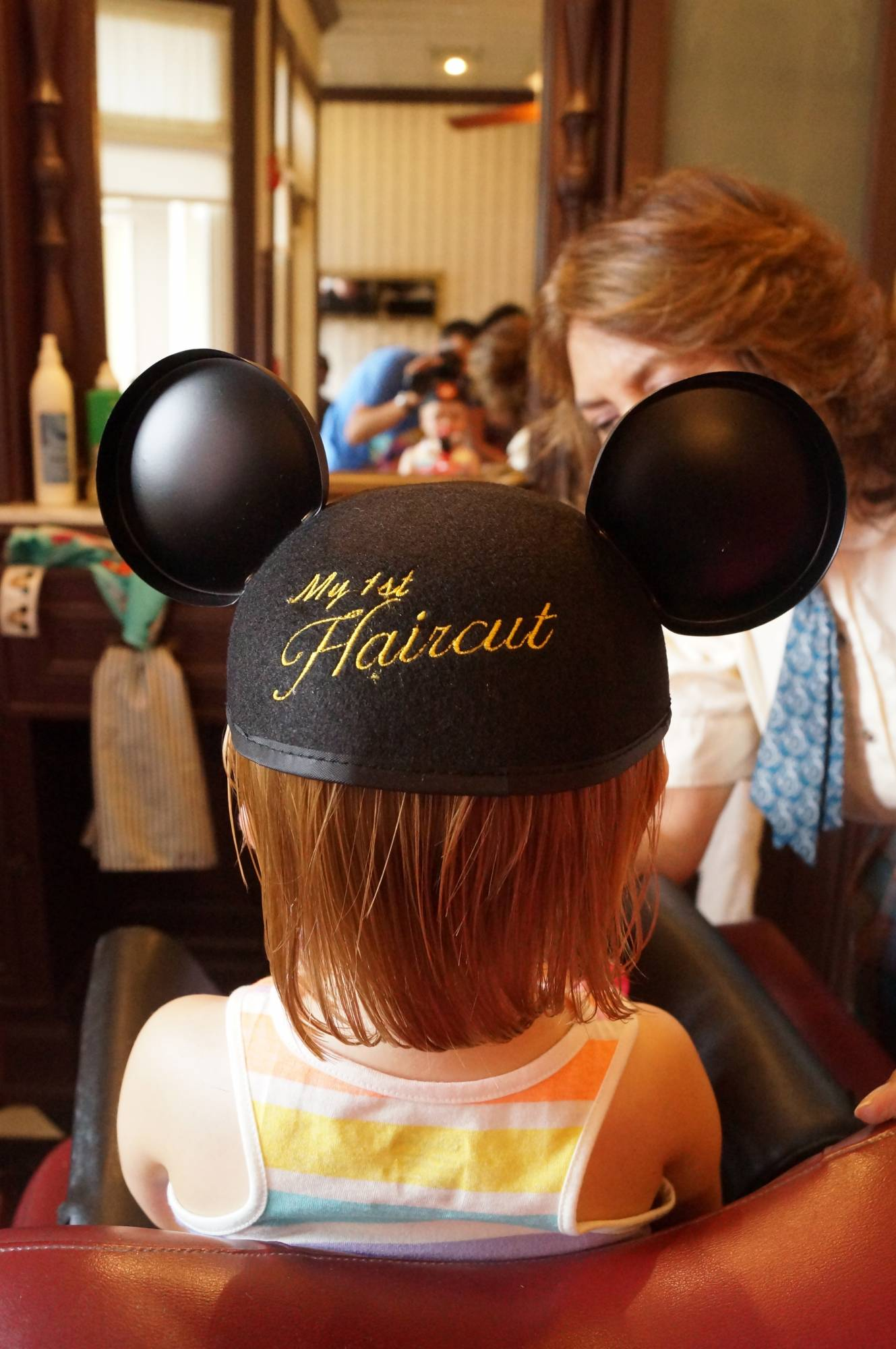 Little ones can get their first haircut at the Harmony Barber Shop in the Magic Kingdom |PassPorter.com