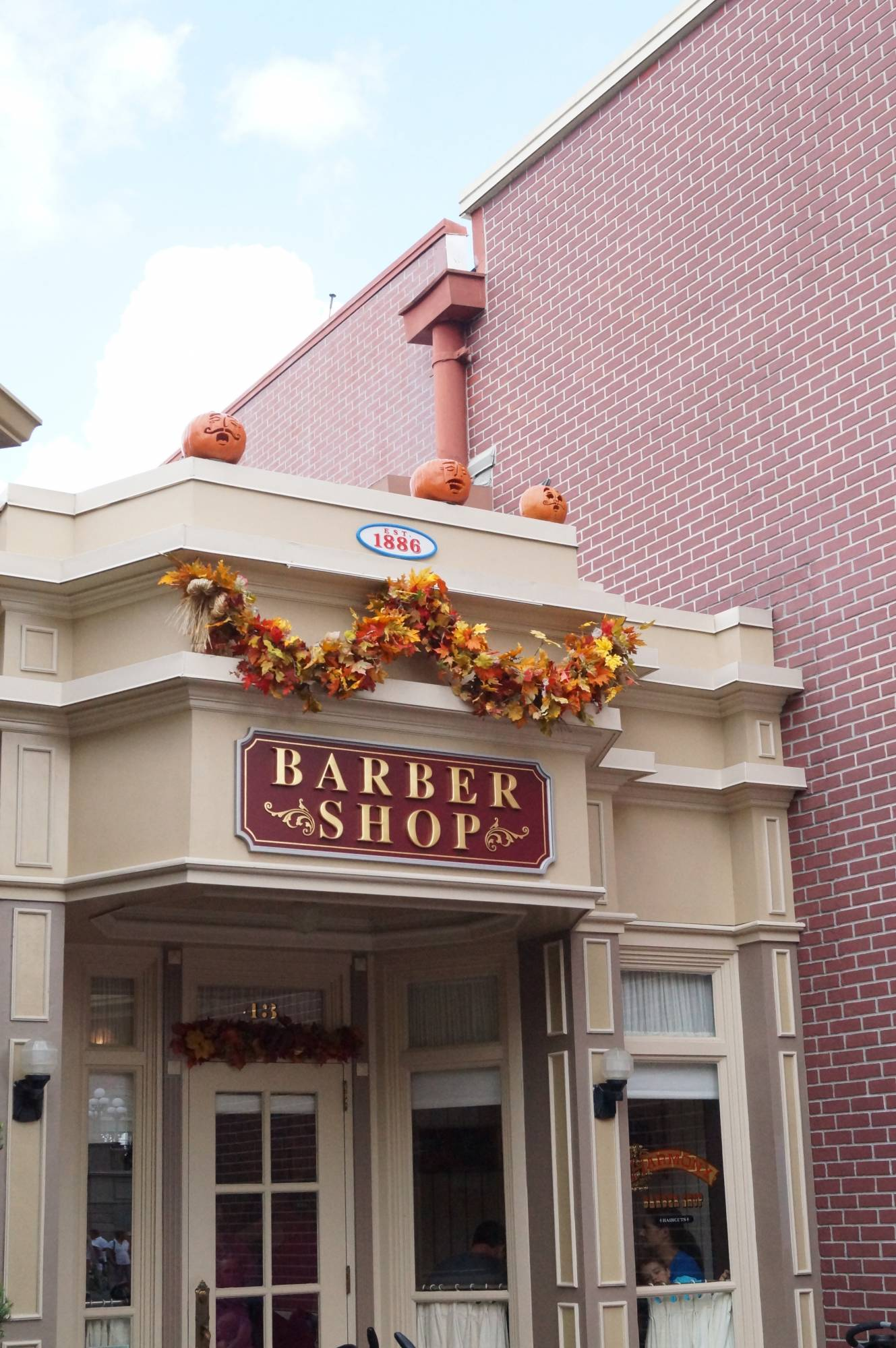 Little ones can get their first haircut at the Harmony Barber Shop in the Magic Kingdom | PassPorter.com