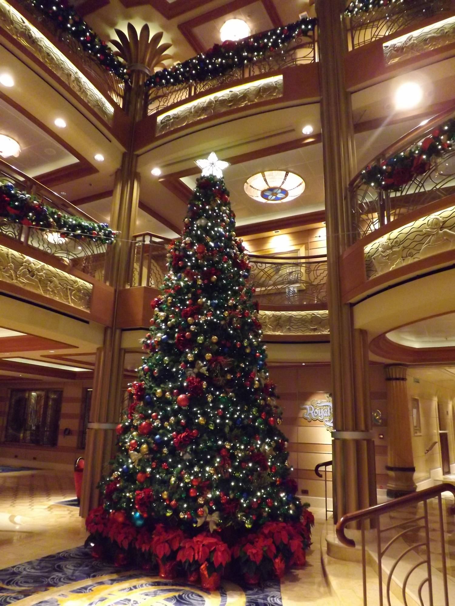 enjoy the magic of the holidays onboard a disney cruise ship passportercom atrium christmas decorations - When Do Cruise Ships Decorated For Christmas