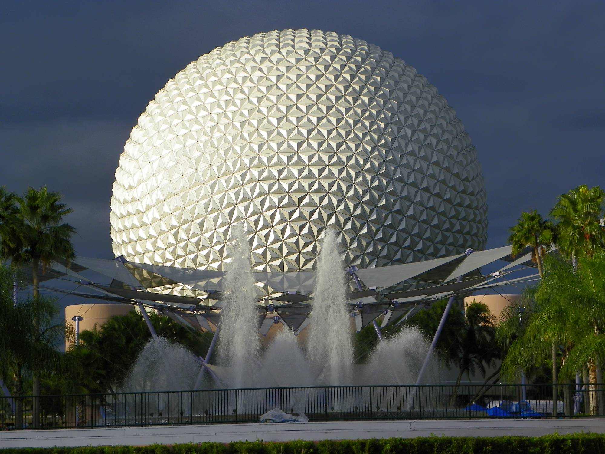 Sun shining off Spaceship Earth against a stormy sky