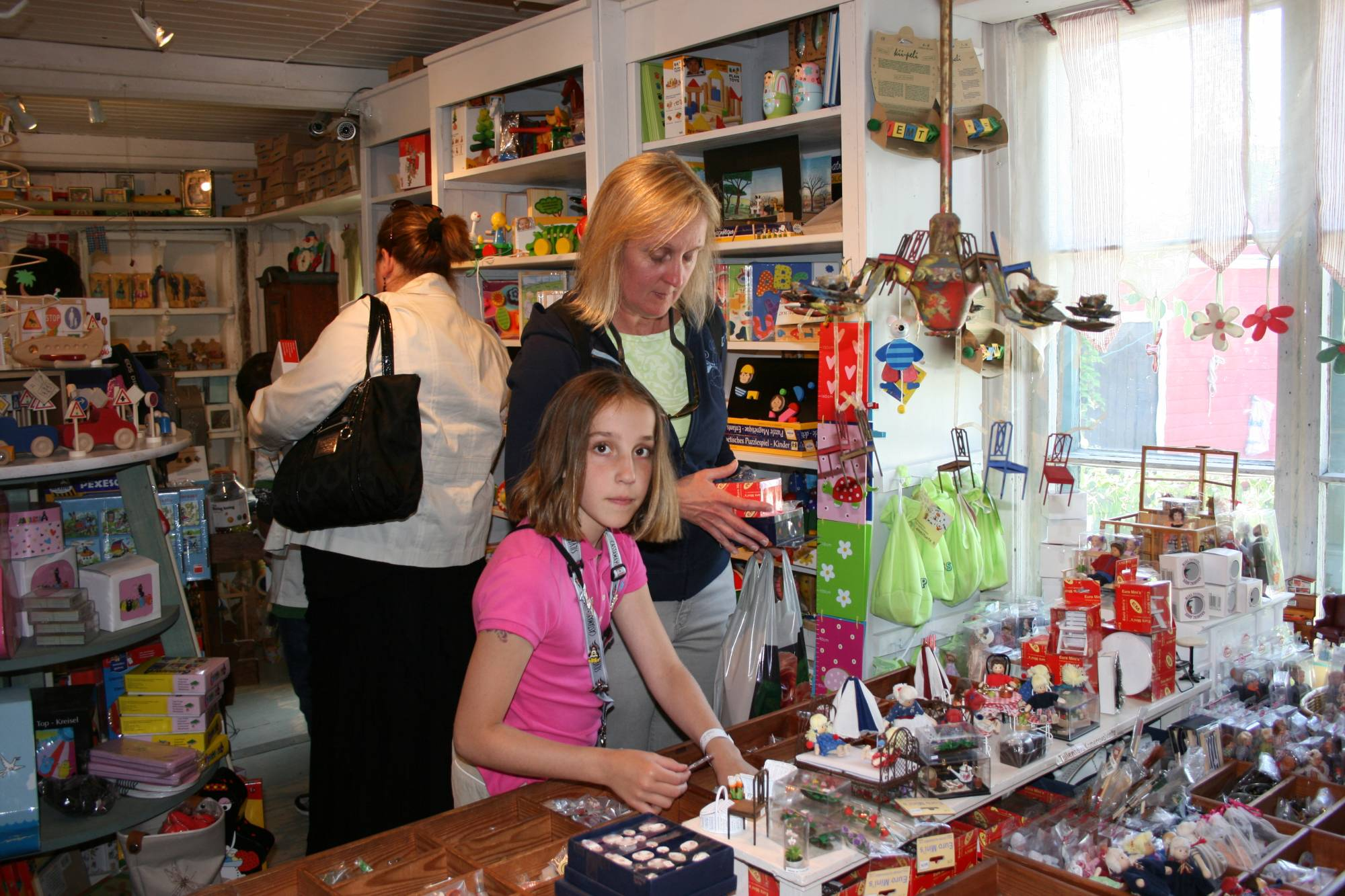 Checking out the doll house furniture at Riimikko Toy Store, Porvoo, Finlan